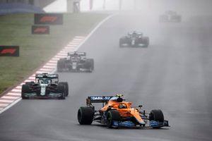 Lando Norris, McLaren MCL35M, Lance Stroll, Aston Martin AMR21, and Yuki Tsunoda, AlphaTauri AT02