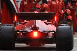 Charles Leclerc, Ferrari SF21, makes a pit stop