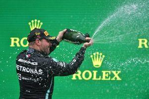 Valtteri Bottas, Mercedes, 1st position, sprays the victory Champagne