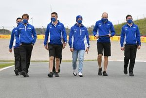 Mick Schumacher, Haas VF-21 track walk with team members.