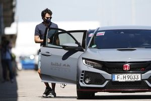 Sergio Perez, Red Bull Racing, arrives at the circuit in a Honda Civic Type R