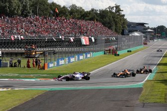 Sergio Perez, Racing Point RP19, leads Lando Norris, McLaren MCL34, and Max Verstappen, Red Bull Racing RB15