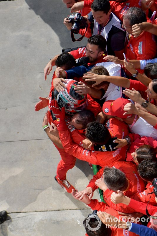 Charles Leclerc, Ferrari, 1st position, celebrates in Parc Ferme with his team