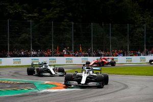 Lewis Hamilton, Mercedes AMG F1 W10, leads Valtteri Bottas, Mercedes AMG W10, and Sebastian Vettel, Ferrari SF90