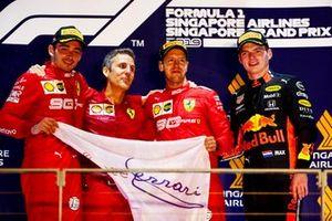 Charles Leclerc, Ferrari, Race winner Sebastian Vettel, Ferrari and Max Verstappen, Red Bull Racing celebrate on the podium