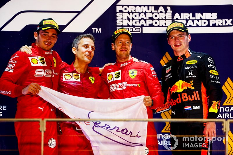 Charles Leclerc, Ferrari, Race winner Sebastian Vettel, Ferrari and Max Verstappen, Red Bull Racing celebrate on the podium