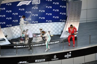 Fred Judd, Chief Engineer Trackside, Mercedes AMG F1, Valtteri Bottas, Mercedes AMG F1, 2nd position, Lewis Hamilton, Mercedes AMG F1, 1st position, and Charles Leclerc, Ferrari, 3rd position, celebrate on the podium