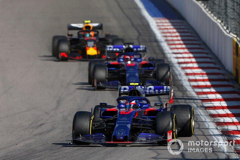 Pierre Gasly, Toro Rosso STR14, leads Daniil Kvyat, Toro Rosso STR14, and Alex Albon, Red Bull RB15