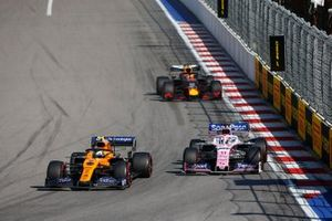 Lando Norris, McLaren MCL34, leads Lance Stroll, Racing Point RP19, and Max Verstappen, Red Bull Racing RB15