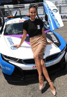 Irina Shayk sits on the BMW i8 Safety car