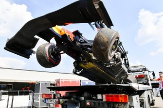 The damaged car of Pierre Gasly, Red Bull Racing RB15, on a flat bed truck