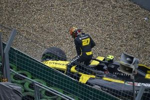 Nico Hulkenberg, Renault F1 Team, climbs out of his damaged car and retires from the race