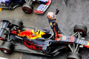 Max Verstappen, Red Bull Racing, 1st position, and Daniil Kvyat, Toro Rosso, 3rd position, arrive in Parc Ferme