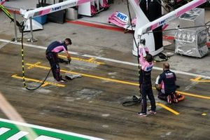 Racing Point team dry the pit lane