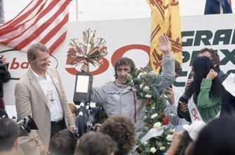 Podium: Race winner Jackie Stewart, Tyrrell 005-Ford Cosworth