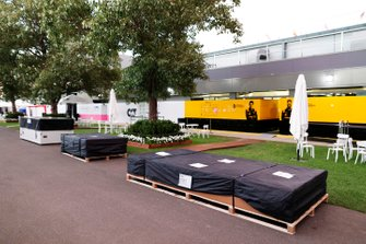 Packing crates outside the Renault garage in the paddock