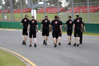 Romain Grosjean, Haas F1 walks the track with members of the team