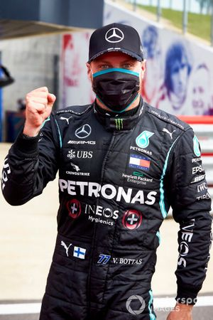Valtteri Bottas, Mercedes AMG F1, celebrates after securing pole