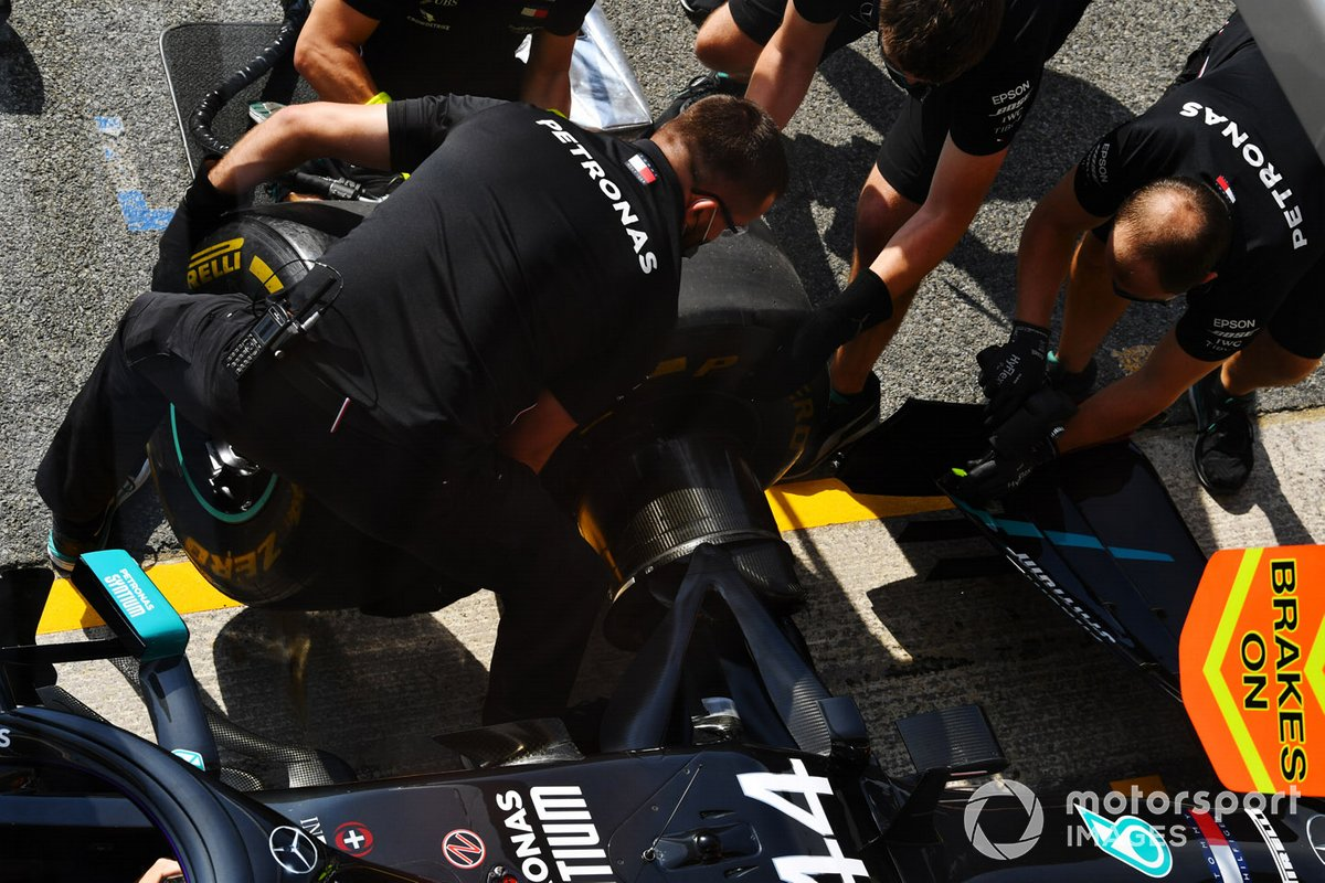 The Mercedes team practice a pit stop
