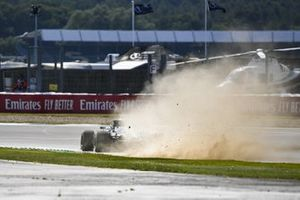 Lewis Hamilton, Mercedes F1 W11, kicks up dust and sparks