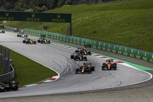Max Verstappen, Red Bull Racing RB16, leads Carlos Sainz Jr., McLaren MCL35, Valtteri Bottas, Mercedes F1 W11 EQ Performance, Alex Albon, Red Bull Racing RB16, and the remainder of the field at the start