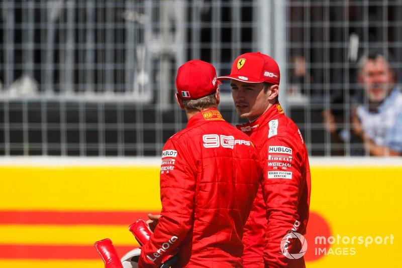 Pole man Sebastian Vettel, Ferrari, talks with Charles Leclerc, Ferrari, after Qualifying