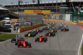 Sebastian Vettel, Ferrari SF90, leads Lewis Hamilton, Mercedes AMG F1 W10, Charles Leclerc, Ferrari SF90, Daniel Ricciardo, Renault R.S.19, Pierre Gasly, Red Bull Racing RB15, and the rest of the field at the start