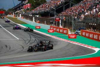 Romain Grosjean, Haas F1 Team VF-19, leads Kevin Magnussen, Haas F1 Team VF-19, and Daniil Kvyat, Toro Rosso STR14