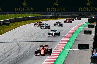 Charles Leclerc, Ferrari SF90, leads Valtteri Bottas, Mercedes AMG W10, Lewis Hamilton, Mercedes AMG F1 W10, Lando Norris, McLaren MCL34, Kimi Raikkonen, Alfa Romeo Racing C38, Sebastian Vettel, Ferrari SF90, and the rest of the field at the start