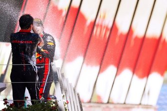 Max Verstappen, Red Bull Racing, 1st position, sprays Champagne at Toyoharu Tanabe, F1 Technical Director, Honda, on the podium
