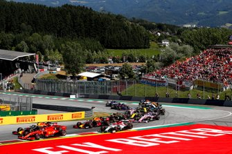 Sebastian Vettel, Ferrari SF90, leads Max Verstappen, Red Bull Racing RB15, Pierre Gasly, Red Bull Racing RB15, Antonio Giovinazzi, Alfa Romeo Racing C38, Kevin Magnussen, Haas F1 Team VF-19, Sergio Perez, Racing Point RP19, and the remainder of the field at the start