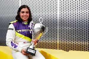 Jamie Chadwick celebrates after winning the race