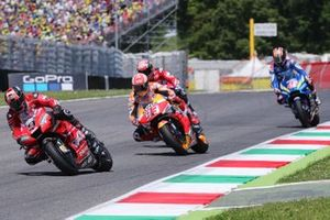 Danilo Petrucci, Ducati Team leads Marc Marquez, Repsol Honda Team