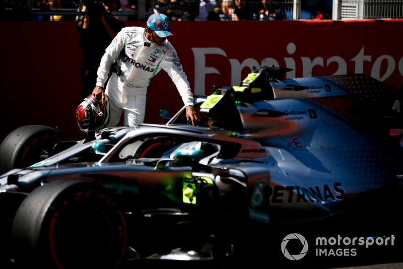 Lewis Hamilton, Mercedes AMG F1 W10, inspects his car after Qualifying