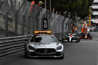 The Safety Car leads Lewis Hamilton, Mercedes AMG F1 W10, and Max Verstappen, Red Bull Racing RB15