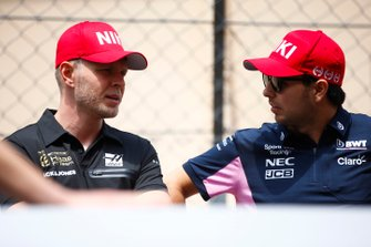 Kevin Magnussen, Haas F1, with Sergio Perez, Racing Point