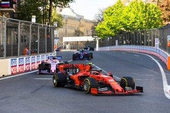 Charles Leclerc, Ferrari SF90, leads Lance Stroll, Racing Point RP19, and Alexander Albon, Toro Rosso STR14