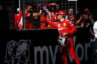 Charles Leclerc, Ferrari, celebrates pole with his team