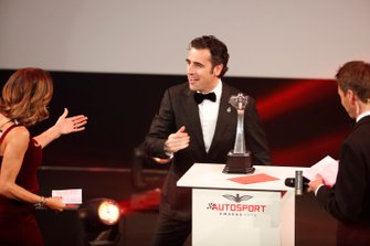 Dario Fanchitti on stage to present the British Competition Driver of the Year award