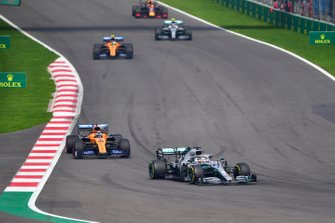 Lewis Hamilton, Mercedes AMG F1 W10, leads Carlos Sainz Jr., McLaren MCL34, Lando Norris, McLaren MCL34, and Valtteri Bottas, Mercedes AMG W10