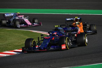 Pierre Gasly, Toro Rosso STR14, leads Lando Norris, McLaren MCL34, and Lance Stroll, Racing Point RP19