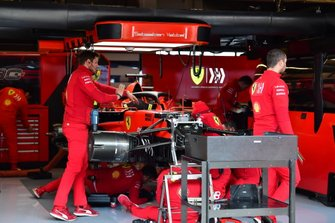 Mechanics work on the car of Sebastian Vettel, Ferrari SF90