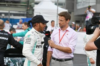 Lewis Hamilton, Mercedes AMG F1, 1st position, is interviewed by Jenson Button, Sky Sports F1, after the race