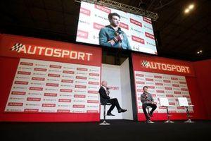 Presenter Alan Hyde interviews Lando Norris, McLaren on the Autosport stage