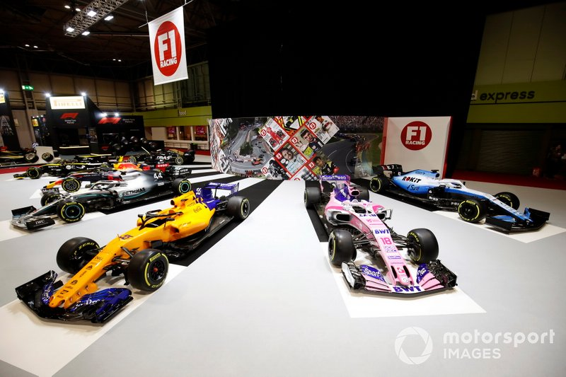 The cars on the F1 Racing stand