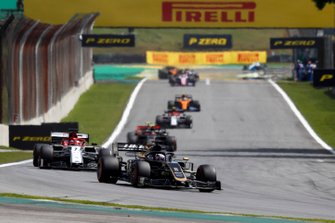 Romain Grosjean, Haas F1 Team VF-19, leads Kimi Raikkonen, Alfa Romeo Racing C38, and Kevin Magnussen, Haas F1 Team VF-19