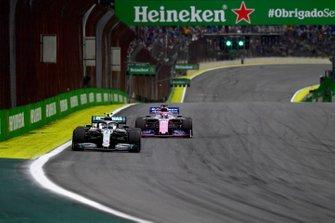 Valtteri Bottas, Mercedes AMG W10, leads Sergio Perez, Racing Point RP19