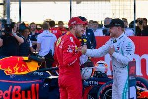 Sebastian Vettel, Ferrari, congratulates Valtteri Bottas, Mercedes AMG F1, on securing pole