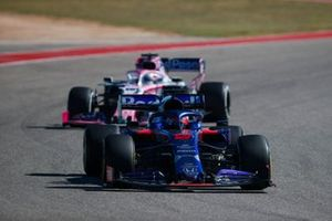 Daniil Kvyat, Toro Rosso STR14, leads Sergio Perez, Racing Point RP19