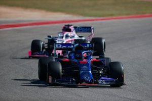 Daniil Kvyat, Toro Rosso STR14, leads Sergio Perez, Racing Point RP19